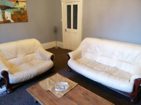 Cream leather and solid wood 2 and 3 seater sofas