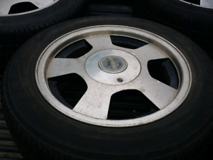 5 spoke alloy rims with all season tires