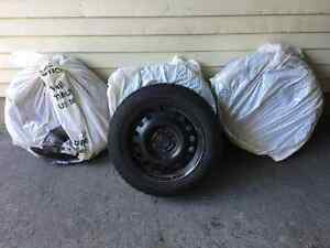 Goodyear Ultra Grip Winter Tires on Rims - Like New!