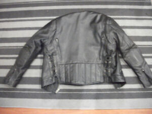 Motorcycle black leather jacket. New without tags