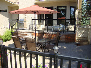Large oval glass top patio table with 6 chairs