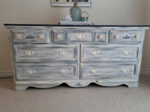 Unique dresser makeover with layered paint.