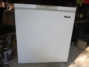 """Woods brand Freezer, measures approximately 32""""w x 36""""h x 22""""d."""