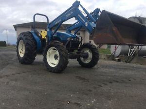New Holland TN55S Tractor has 4wd, with loader