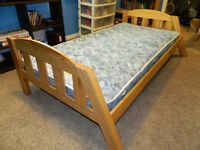Child's single wood bed with mattress