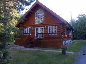 """NEW PRICE""  Gorgeous 4-bedroom Canadian Log Home"