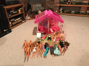 Barbie house, dolls and clothing