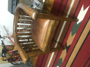 Antique Arts & Crafts wood and leather armchair.