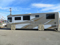 Rent this 37' Gas Pusher Motor Home from Solomon RV $1,900/week