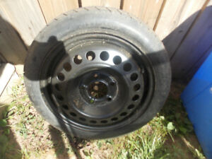 GM SPARE TIRE FROM A 2001 CHEVROLET MALIBU - NEVER USED