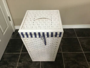 White basket type clothes hamper