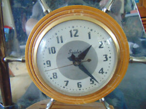 SHIP SHAPED CLOCK VERY OLD WOOD AND STEEL