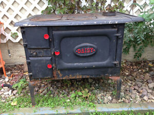 "Antique ""Daisy"" wood stove"