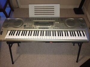 Keyboard with metal stand and music sheet holder