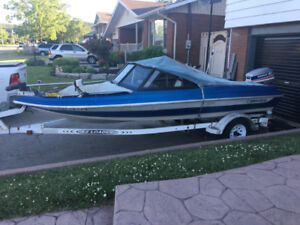 Great fishing boat and EZ load trailer With 2 sea doos.