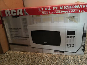 RCA White Microwave Oven 1.1 Cft - Slightly Used - Must Go