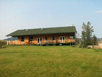 Spacious ranch style log sided home in Grande Cache