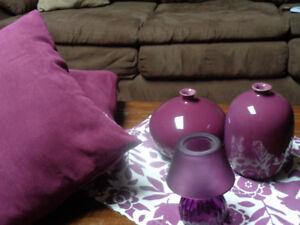 Purple vases, pillows, glass tealight holder