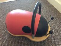 Wooden ladybird ride along
