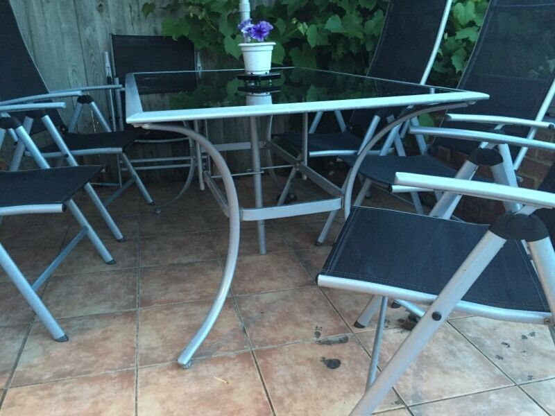 Glass and metal garden table and chairs in wembley for Outdoor furniture gumtree