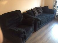 Black fabric sofa c/w recliner chair, snuggle chair and footstool