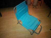 Folding beach chair with storage pocket