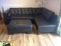 Leather corner sofa and matching foot stool