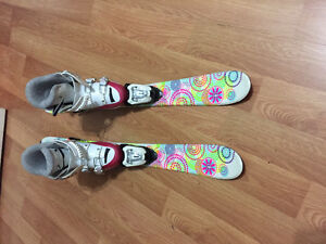 Young girl skis and boots