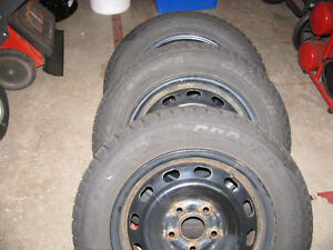 Four 195/65/15 winter tires on rims