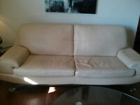 4 year old contemporary cream leather couch & love seat