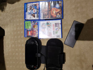 Ps Vita with games and memory cards
