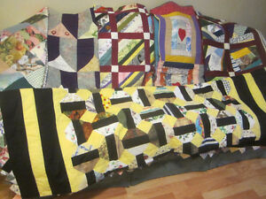 Several hand-made quilts