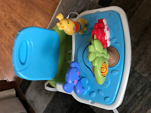 Booster chair with front toy tray