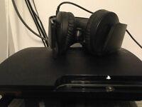 PS3 slim 250gb 2 manettes + Casque d'écoute PS3 + 21 jeux