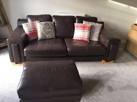 Brown leather sofa and chair and foot rest