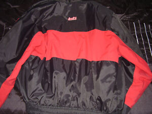 Official authentic used Coca-Cola winter jacket with polar.