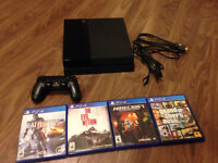 Playstation 4 with box and 4 games.