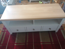 Pine and white wood TV stand for sale.