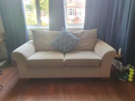 Beige 2 seater sofa