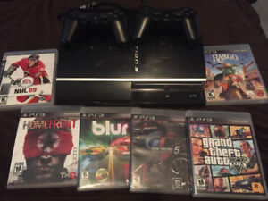 PS3 consule includes games and 2 controllers $80 obo