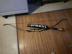 Selling bow and 12 arrows 150$ o.b.o