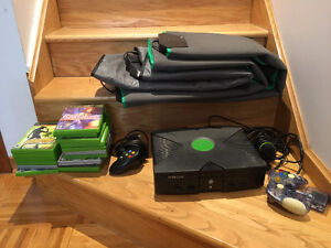 Original Xbox with Dance pads and microphone.