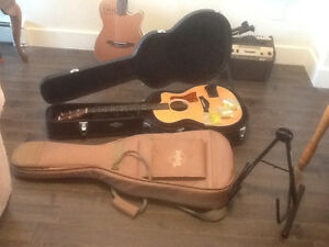 Taylor 114ce acoustic/electric with accessories. Mint condition.