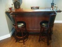 Beautiful bar and 3 bar stool set for a recroom