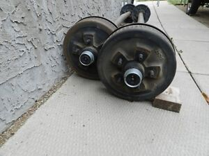 Two 3,500 lb axles, with Electric Brake, Hubs, Bearings, Lugs - Regina Regina Area image 1