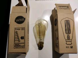 2x brand new 150 lumen B22 smoked glass Edison lightbulbs. William Fra