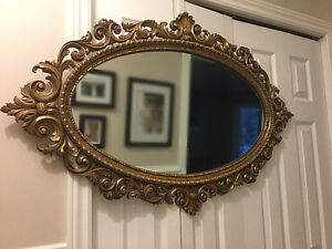 Very large oval ornate mirror