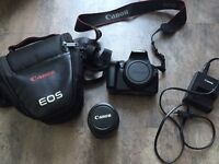 Digital camera Canon EOS 1100D lens 18-55mm bag SD card charger