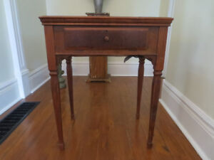 Beautiful antique hall table with sewing machine inside of it