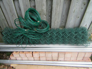 Green chain link and steel posts and hardware.